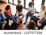 female tutor leading discussion ... | Shutterstock . vector #1127577206