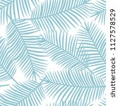 light blue palm leaves on a... | Shutterstock . vector #1127578529