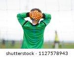 young canadian soccer goalie... | Shutterstock . vector #1127578943