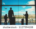 father with kids and luggage... | Shutterstock . vector #1127594108