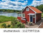 Red Scandinavian Wooden House...