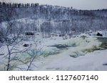 almost frozen stream in the... | Shutterstock . vector #1127607140