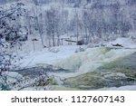 almost frozen stream in the... | Shutterstock . vector #1127607143