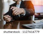 businessman plying video games... | Shutterstock . vector #1127616779