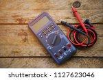 digital multimeter and wiring... | Shutterstock . vector #1127623046