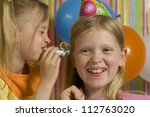 Happy children with birthdaywhistle on a striped background - stock photo