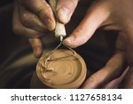 master removes the top layer of ... | Shutterstock . vector #1127658134