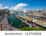 SYDNEY - FEBRUARY 20: The busy harour at Circular Quay, a transit hub,  with a view of the Sydney Opera House on February 20, 2012 in Sydney, Australia. - stock photo