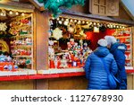 people at the stall on... | Shutterstock . vector #1127678930