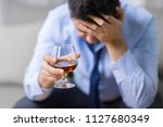 alcoholism  alcohol addiction... | Shutterstock . vector #1127680349