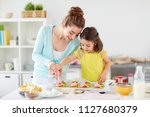 family  cooking and people... | Shutterstock . vector #1127680379