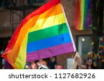 a rainbow flag waves above the... | Shutterstock . vector #1127682926
