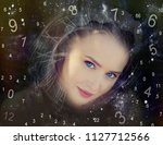 woman face and numerology world | Shutterstock . vector #1127712566