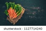 fresh carrots in a wooden box....   Shutterstock . vector #1127714240