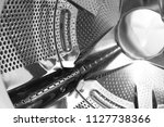 perforated steel drum of... | Shutterstock . vector #1127738366