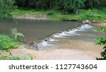 check dam in the forest . | Shutterstock . vector #1127743604