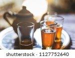 close up of a moroccan tea pot... | Shutterstock . vector #1127752640
