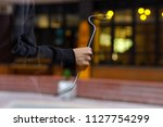 burglar with a crowbar on the... | Shutterstock . vector #1127754299