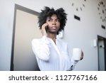 black businesswoman talking on... | Shutterstock . vector #1127767166