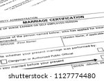 marriage certificate paperwork... | Shutterstock . vector #1127774480