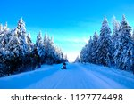 snowmobiling on snowy mountain...   Shutterstock . vector #1127774498