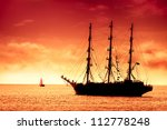 Tall Ship Sailing In Red  ...