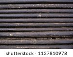 oil drill pipe. rusty drill... | Shutterstock . vector #1127810978