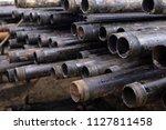 oil drill pipe. rusty drill... | Shutterstock . vector #1127811458