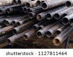 oil drill pipe. rusty drill... | Shutterstock . vector #1127811464