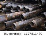 oil drill pipe. rusty drill... | Shutterstock . vector #1127811470
