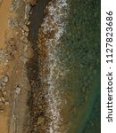 aerial view of sandy beach with ... | Shutterstock . vector #1127823686