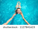 beautiful young woman swimming... | Shutterstock . vector #1127841623