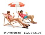 tourists with cocktails sitting ... | Shutterstock . vector #1127842106