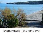beach in torre dell' orso near... | Shutterstock . vector #1127842190
