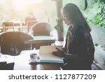 young beautiful woman reading... | Shutterstock . vector #1127877209