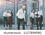 a young male businessman is... | Shutterstock . vector #1127898980