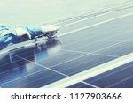 engineer team working on... | Shutterstock . vector #1127903666