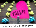 writing note showing quiz... | Shutterstock . vector #1127905370