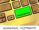 Small photo of Text sign showing Transcription. Conceptual photo Written or printed process of transcribing words text voice Keyboard key laptop creative computer brown keypad idea notebook netbook.