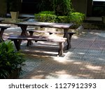brown wooden chair in the park | Shutterstock . vector #1127912393