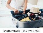 overhead view of traveler's... | Shutterstock . vector #1127918753