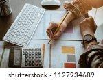 close up business woman using... | Shutterstock . vector #1127934689