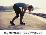 woman runner with sports... | Shutterstock . vector #1127945789