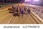 Stock photo horse race at night 1127945873