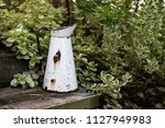 an old  rusted  white and blue...   Shutterstock . vector #1127949983