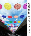 hanging colorful umbrellas on...   Shutterstock . vector #1127973983