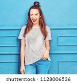 young stylish girl model in... | Shutterstock . vector #1128006536