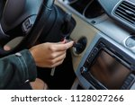 a girl inserts the ignition key | Shutterstock . vector #1128027266