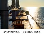 view from cargo ship at sea to... | Shutterstock . vector #1128034556
