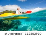 Young Woman Kayaking In A...